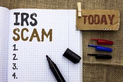 Text sign showing Irs Scam. Conceptual photo Warning Scam Fraud Tax Pishing Spam Money Revenue Alert Scheme written on Notebook Bo Stock Images