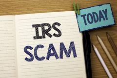 Text sign showing Irs Scam. Conceptual photo Warning Scam Fraud Tax Pishing Spam Money Revenue Alert Scheme written on Notebook Bo Royalty Free Stock Images