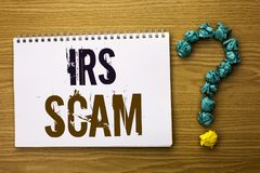 Text sign showing Irs Scam. Conceptual photo Warning Scam Fraud Tax Pishing Spam Money Revenue Alert Scheme written on Notebook Bo Royalty Free Stock Photo