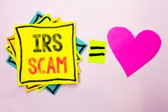 Text sign showing Irs Scam. Conceptual photo Warning Scam Fraud Tax Pishing Spam Money Revenue Alert Scheme written on Stacked Sti Royalty Free Stock Image