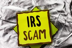 Text sign showing Irs Scam. Conceptual photo Warning Scam Fraud Tax Pishing Spam Money Revenue Alert Scheme written on Stacked Sti Royalty Free Stock Photos