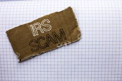 Text sign showing Irs Scam. Conceptual photo Warning Scam Fraud Tax Pishing Spam Money Revenue Alert Scheme written on tear Cardbo Royalty Free Stock Images