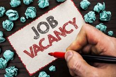 Text sign showing Job Vacancy. Conceptual photo Work Career Vacant Position Hiring Employment Recruit Job written by Man Holding M. Arker Cardboard Piece the royalty free stock photo