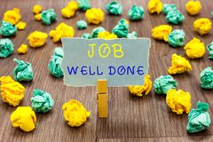 Text sign showing Job Well Done. Conceptual photo Well Performed You did it Cheers Approval Par Accomplished Clothespin. Holding gray note paper crumpled papers royalty free stock images
