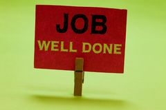 Text sign showing Job Well Done. Conceptual photo Well Performed You did it Cheers Approval Par Accomplished Clothespin holding re. D paper important stock image