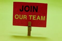 Text sign showing Join Our Team. Conceptual photo Allied Associate Work with us New Employee Hired Enlist Clothespin holding red p. Aper important communicating royalty free stock photography