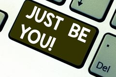Text sign showing Just Be You. Conceptual photo Keep being authentic unique yourself Motivation Inspiration Keyboard key Intention. To create computer message stock photo