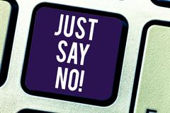 Text sign showing Just Say No. Conceptual photo Do not be afraid of giving negative answers to some things Keyboard key. Intention to create computer message royalty free stock images