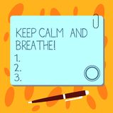 Text sign showing Keep Calm And Breathe. Conceptual photo Take a break to overcome everyday difficulties Blank Square. Color Board with Magnet Click Ballpoint stock illustration