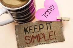 Text sign showing Keep It Simple Motivational Call. Conceptual photo Simplify Things Easy Clear Concise Ideas written on Tear Card. Text sign showing Keep It Stock Photo