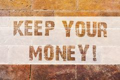 Text sign showing Keep Your Money. Conceptual photo Save incomes for the future Invest financial balance Brick Wall art. Like Graffiti motivational call written royalty free stock photography