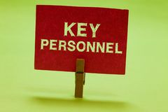 Text sign showing Key Personnel. Conceptual photo Program Directors Principal Investigator Project Executives Clothespin. Holding red paper important royalty free stock photos