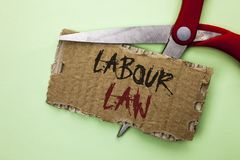 Text sign showing Labour Law. Conceptual photo Employment Rules Worker Rights Obligations Legislation Union written on Tear Cardbo. Text sign showing Labour Law Stock Photos