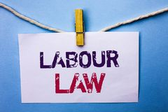 Text sign showing Labour Law. Conceptual photo Employment Rules Worker Rights Obligations Legislation Union written on White Note. Text sign showing Labour Law Royalty Free Stock Photography