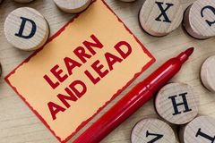 Text sign showing Learn And Lead. Conceptual photo Improve the skills and knowleadge to fit for the leadership.  royalty free stock image