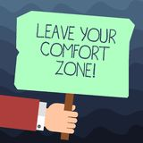 Text sign showing Leave Your Comfort Zone. Conceptual photo Make changes evolve grow take new opportunities Hu analysis. Hand Holding Blank Colored Placard with royalty free illustration