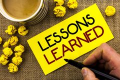 Text sign showing Lessons Learned. Conceptual photo Experiences that should be taken into account in the future written on Sticky. Text sign showing Lessons Royalty Free Stock Images