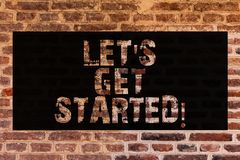 Text sign showing Let S Get Started. Conceptual photo beginning time motivational quote Inspiration encourage Brick Wall art like. Graffiti motivational call stock photography
