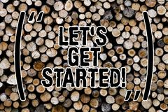 Text sign showing Let S Get Started. Conceptual photo beginning time motivational quote Inspiration encourage Wooden background. Vintage wood wild message ideas royalty free stock image