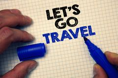 Text sign showing Let'S Go Travel. Conceptual photo Going away Travelling Asking someone to go outside Trip Graph paper grey impo. Rtant thoughts ideas Royalty Free Stock Image