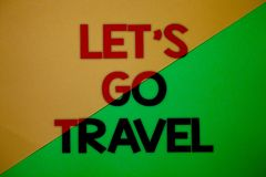 Text sign showing Let\'S Go Travel. Conceptual photo Going away Travelling Asking someone to go outside Trip Yellow green split ba. Ckground message thoughts Royalty Free Stock Photos