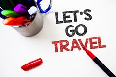 Text sign showing Let\'S Go Travel. Conceptual photo Going away Travelling Asking someone to go outside Trip Pen white background. Grey shadow important temple Royalty Free Stock Photography