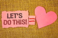 Text sign showing Let Us Do This Motivational Call. Conceptual photo Encourage to start something Inspirational Text pink torn not. E equals is pink heart love Stock Images