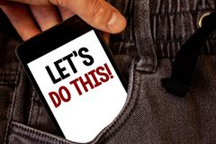 Text sign showing Let Us Do This Motivational Call. Conceptual photo Encourage to start something Inspirational Text two words on. White screen black Phone Hand royalty free stock photo