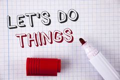 Text sign showing Let Us Do Things. Conceptual photo Try something new find happiness mastering it by practice written on Notebook. Text sign showing Let Us Do stock photo