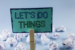 Text sign showing Let Us Do Things. Conceptual photo Try something new find happiness mastering it by practice written on Sticky N. Text sign showing Let Us Do stock photo
