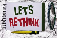 Text sign showing Let Us Rethink. Conceptual photo Give people time to think things again Remodel Redesign written on Notebook Boo Stock Photos