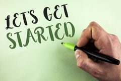Text sign showing Lets Get Started. Conceptual photo beginning time motivational quote Inspiration encourage written by Man holdin. G Marker in Hand plain stock images