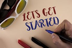 Text sign showing Lets Get Started. Conceptual photo beginning time motivational quote Inspiration encourage written by Man on pla. Text sign showing Lets Get royalty free stock photography