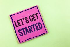 Text sign showing Lets Get Started. Conceptual photo beginning time motivational quote Inspiration encourage written on Pink Stick. Text sign showing Lets Get stock photo