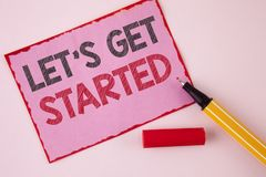 Text sign showing Lets Get Started. Conceptual photo beginning time motivational quote Inspiration encourage written on Pink Stick. Text sign showing Lets Get royalty free stock photos