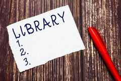 Text sign showing Library. Conceptual photo Building room containing books collections Place for study.  stock photos