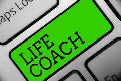 Text sign showing Life Coach. Conceptual photo A person who advices clients how to solve their problems or goals Keyboard green ke. Y Intention create computer royalty free stock photos
