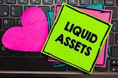 Text sign showing Liquid Assets. Conceptual photo Cash and Bank Balances Market Liquidity Deferred Stock Papers Romantic lovely me. Ssage Heart Keyboard Type stock photo