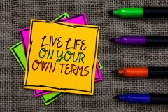 Text sign showing Live Life On Your Own Terms. Conceptual photo Give yourself guidelines for a good living Written on some colorfu. L sticky note 4 pens laid in stock photos