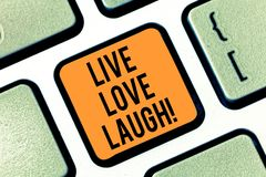 Text sign showing Live Love Laugh. Conceptual photo Be inspired positive enjoy your days laughing good humor Keyboard. Key Intention to create computer message royalty free stock photo