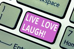Text sign showing Live Love Laugh. Conceptual photo Be inspired positive enjoy your days laughing good humor Keyboard. Key Intention to create computer message stock photos