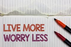 Text sign showing Live More Worry Less. Conceptual photo Have a good attitude motivation be careless enjoy life White torn page wr royalty free stock image