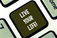 Text sign showing Live Your Life. Conceptual photo Motivation inspiration to follow your dreams accomplish goals stock photos