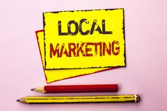 Text sign showing Local Marketing. Conceptual photo Regional Advertising Commercial Locally Announcements written on Yellow Sticky royalty free stock image