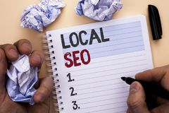 Text sign showing Local Seo. Conceptual photo Search Engine Optimization Strategy Optimize Local Find Keywords written by Man on N. Text sign showing Local Seo Stock Image