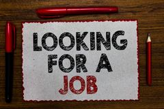 Text sign showing Looking For A Job. Conceptual photo Unemployed seeking work Recruitment Human Resources Red bordered white page. Centered some texts wooden royalty free stock photos