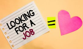 Text sign showing Looking For A Job. Conceptual photo Unemployed seeking work Recruitment Human Resources Transverse white paper w. Ith words equal love heart on royalty free stock images
