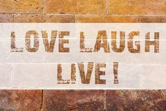 Text sign showing Love Laugh Live. Conceptual photo Be inspired positive enjoy your days laughing good humor Brick Wall. Art like Graffiti motivational call stock photo