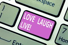 Text sign showing Love Laugh Live. Conceptual photo Be inspired positive enjoy your days laughing good humor Keyboard. Key Intention to create computer message stock photos