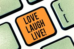 Text sign showing Love Laugh Live. Conceptual photo Be inspired positive enjoy your days laughing good humor Keyboard. Key Intention to create computer message royalty free stock image